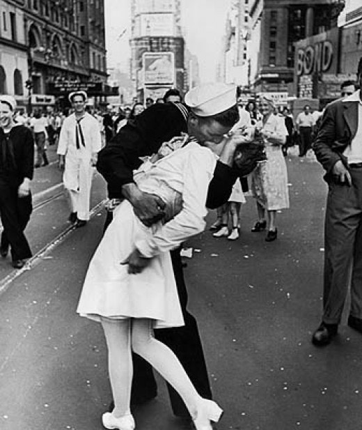 Again Each Photograph Tells A Story The Sailor Cannot Contain His Joy That War Is Over And Grabs Nearest Pretty Girl Kisses Her